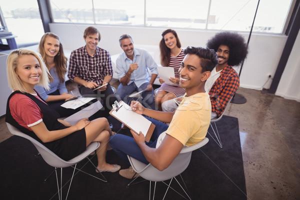 Mosolyog üzletemberek ül megbeszélés iroda portré Stock fotó © wavebreak_media