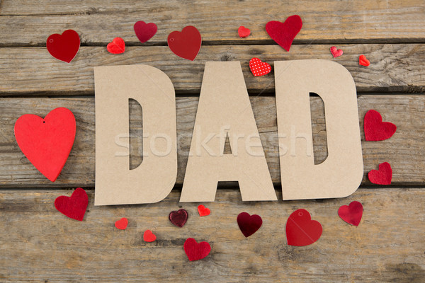 High angle view of dad text with heart shapes on table Stock photo © wavebreak_media
