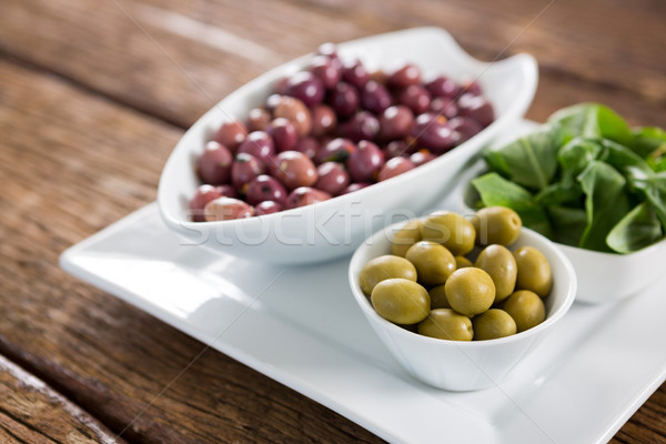Marinated olives with herbs in bowl Stock photo © wavebreak_media