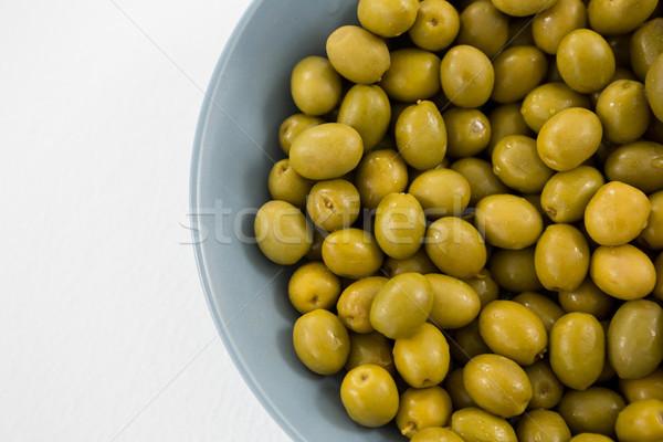 Közelkép marinált olajbogyók tál fehér gyümölcs Stock fotó © wavebreak_media