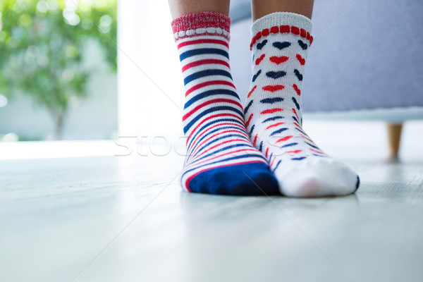 Low section of girl wearing different socks Stock photo © wavebreak_media