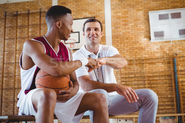 Basketball player doing fist bump with coach Stock photo © wavebreak_media