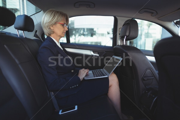Businesswoman using laptop in car Stock photo © wavebreak_media