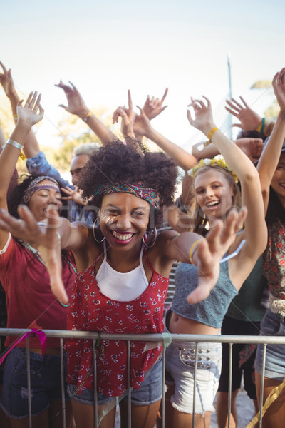 Cheerful young woman by railing enjoying at music festival Stock photo © wavebreak_media