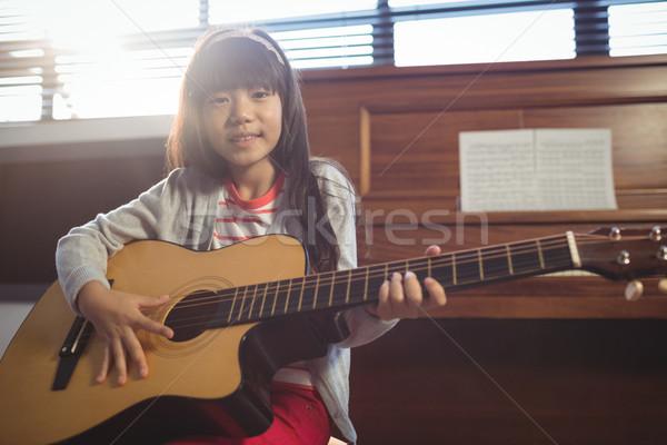 Portrait of girl practicing guitar Stock photo © wavebreak_media