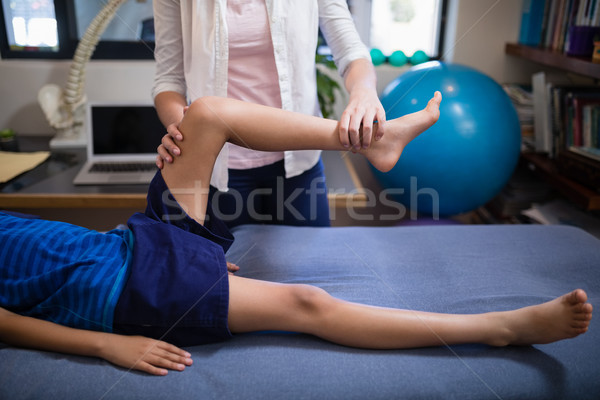 Low section of boy being examined by female therapist Stock photo © wavebreak_media