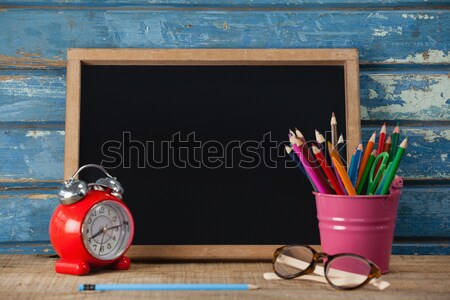 Slate, alarm clock, penholder, pencil and spectacle Stock photo © wavebreak_media