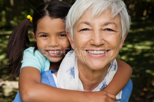 Close-up portrait of smiling grandmother giving piggyback to granddaughter Stock photo © wavebreak_media