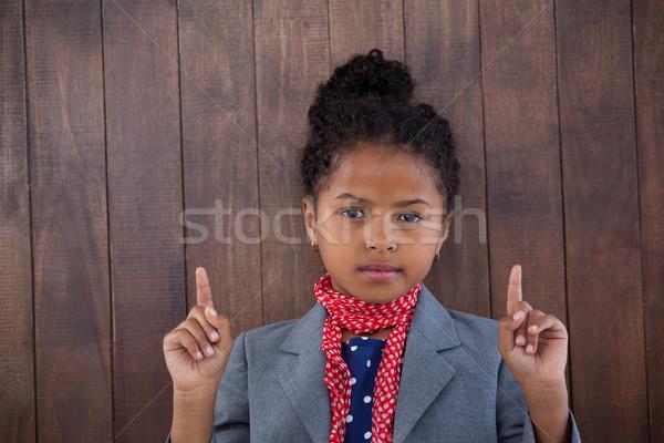 Portrait fille femme d'affaires pointant permanent blanche Photo stock © wavebreak_media