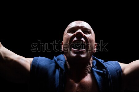 Mid section of shirtless sportsman holding rugby ball against Italian Flag Stock photo © wavebreak_media