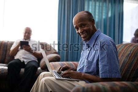 Senior man reading braille book in retirement home Stock photo © wavebreak_media