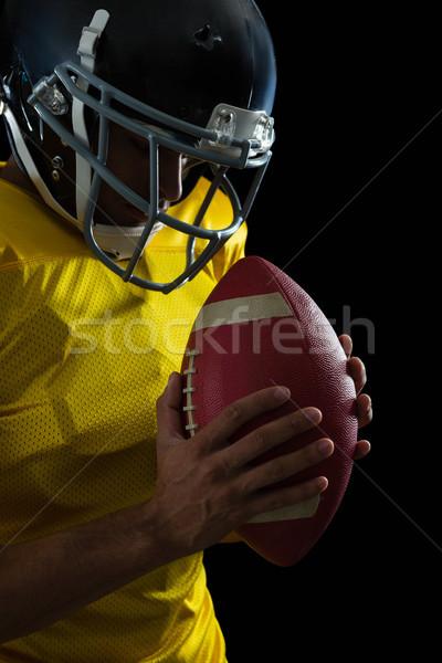 Amerikan futbol her ikisi de eller Stok fotoğraf © wavebreak_media