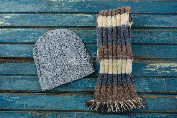 Overhead view of knit hat and scarf on wooden table Stock photo © wavebreak_media