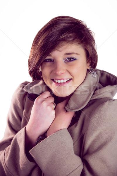 Vonzó nő visel meleg kabát mosolyog nő Stock fotó © wavebreak_media
