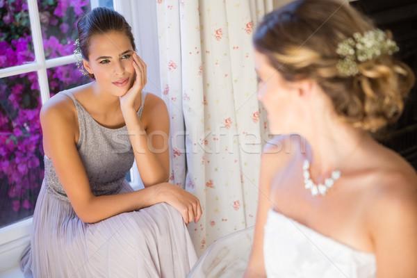 Sposa parlando damigella d'onore home seduta donna Foto d'archivio © wavebreak_media