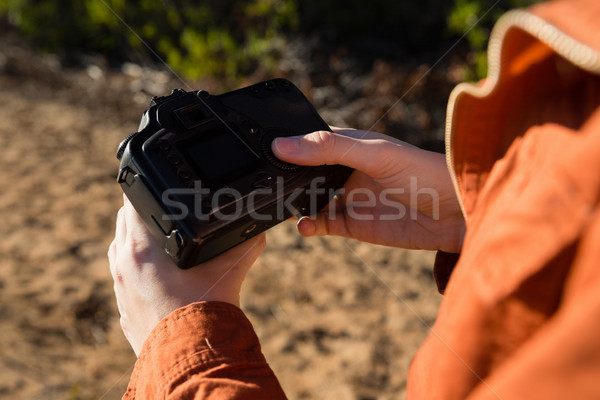 Cropped hands of woman holding camera Stock photo © wavebreak_media