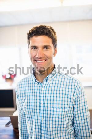 Sorridere uomo d'affari casuale ufficio uomo felice Foto d'archivio © wavebreak_media