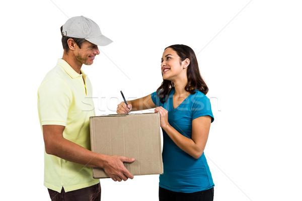 Uśmiechnięta kobieta karton biały człowiek Zdjęcia stock © wavebreak_media