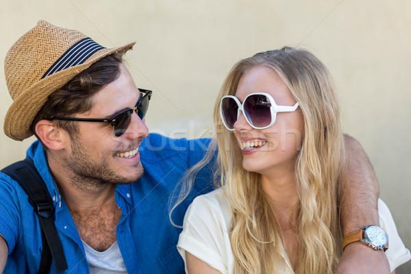 бедро пару улыбаясь другой Солнцезащитные очки человека Сток-фото © wavebreak_media