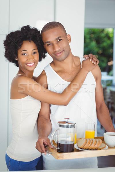 Boldog pár tart reggeli tálca konyha Stock fotó © wavebreak_media