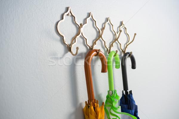カラフル 傘 絞首刑 フック 白 壁 ストックフォト © wavebreak_media