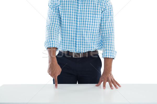 Maschio executive toccare invisibile schermo desk Foto d'archivio © wavebreak_media