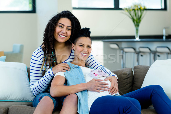 Pregnant lesbian couple with a pair of pink baby shoes Stock photo © wavebreak_media