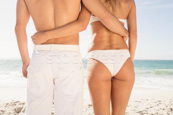 Young couple in beachwear embracing Stock photo © wavebreak_media