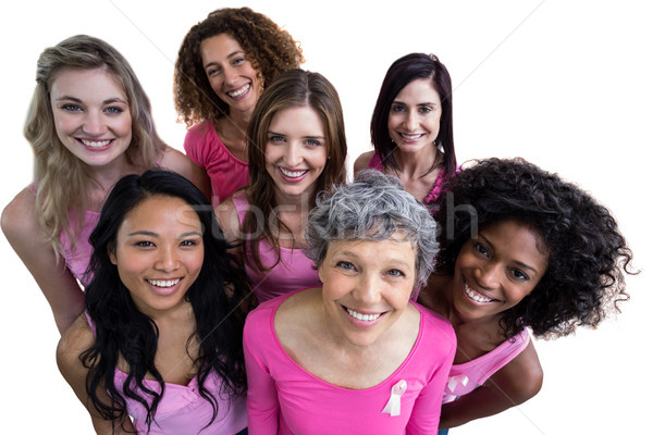 Smiling women in pink outfits posing for breast cancer awareness Stock photo © wavebreak_media