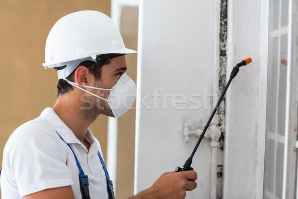 Side view of manual worker spraying pesticide Stock photo © wavebreak_media