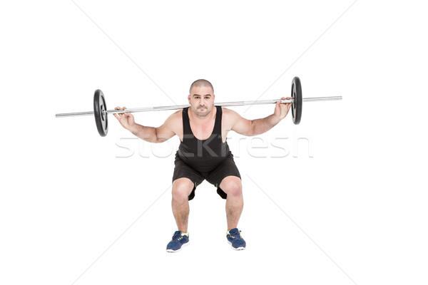 Bodybuilder pesante bilanciere pesi bianco Foto d'archivio © wavebreak_media