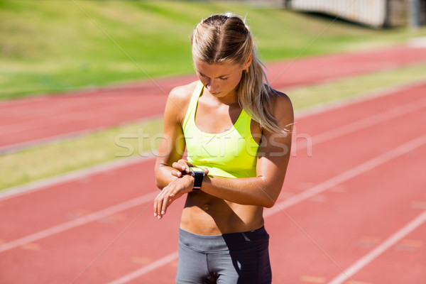 Female athlete checking her smart watch Stock photo © wavebreak_media