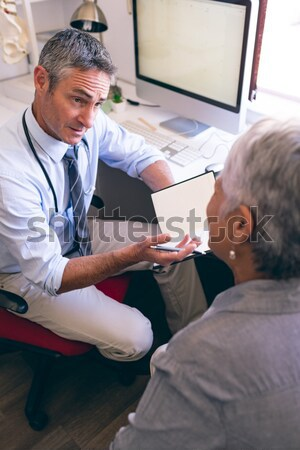 Dentist showing mouth model to female patient Stock photo © wavebreak_media
