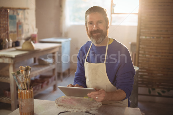 Portrait of male potter using digital tablet Stock photo © wavebreak_media