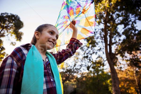 Alulról fotózva kilátás lány tart papírsárkány park Stock fotó © wavebreak_media
