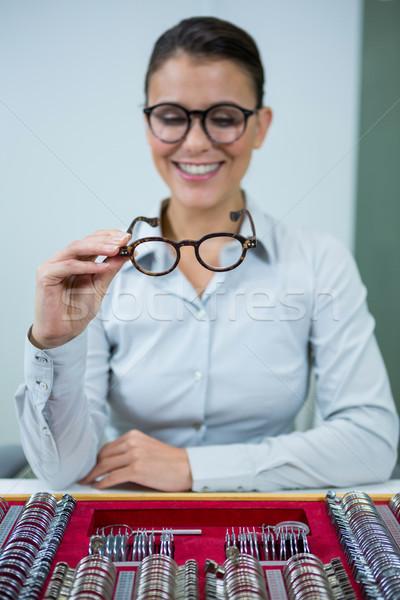 Optician looking at spectacles Stock photo © wavebreak_media