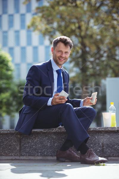 Portrait of handsome businessman having snacks Stock photo © wavebreak_media