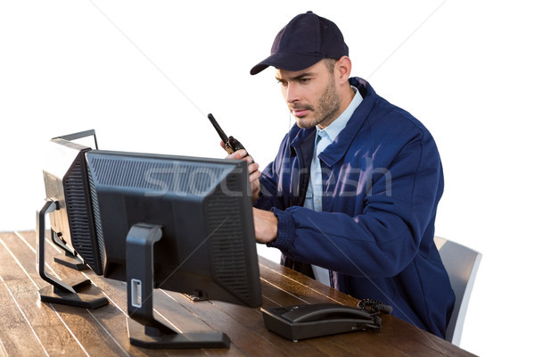 Bezpieczeństwa oficer patrząc komputera mówić człowiek Zdjęcia stock © wavebreak_media