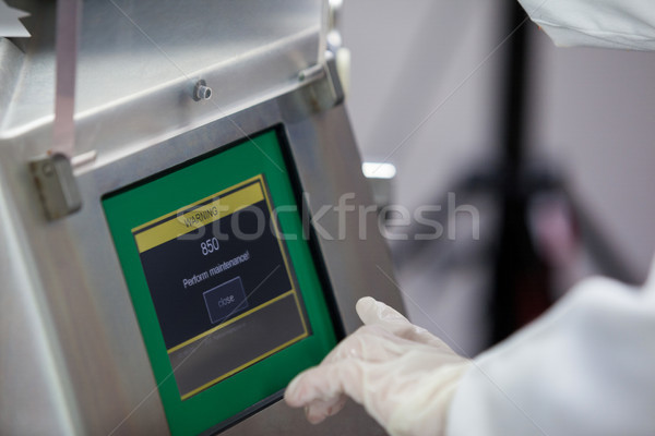 Butcher operating machine at meat factory Stock photo © wavebreak_media