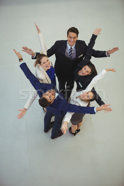 Businesspeople standing together with arms outstretched Stock photo © wavebreak_media