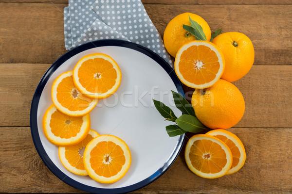 Ломтики апельсинов пластина фрукты оранжевый таблице Сток-фото © wavebreak_media