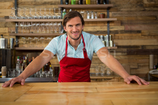 Mosolyog fiatal férfi barista pult kávéház Stock fotó © wavebreak_media