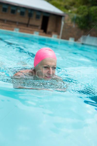 Idős nő visel sapka úszómedence víz Stock fotó © wavebreak_media