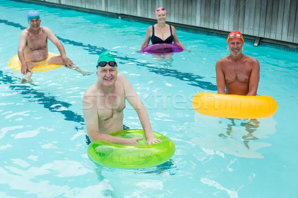Idősek úszik felfújható gyűrűk medence nő Stock fotó © wavebreak_media