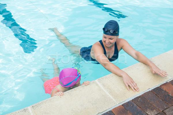 Female instructor training young girl in pool Stock photo © wavebreak_media