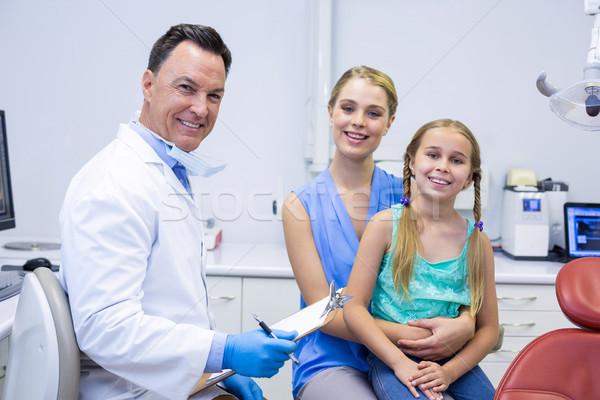 портрет улыбаясь Стоматологи женщины пациент человека Сток-фото © wavebreak_media