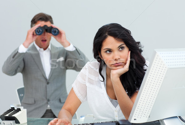 Brunette businesswoman getting bored and her manager looking thr Stock photo © wavebreak_media