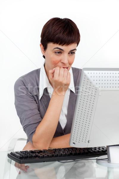 Atraente empresária sessão secretária escritório Foto stock © wavebreak_media
