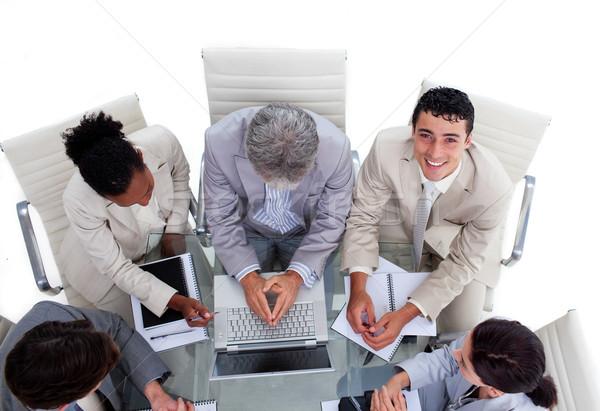 деловые люди заседание используя ноутбук компьютер Сток-фото © wavebreak_media