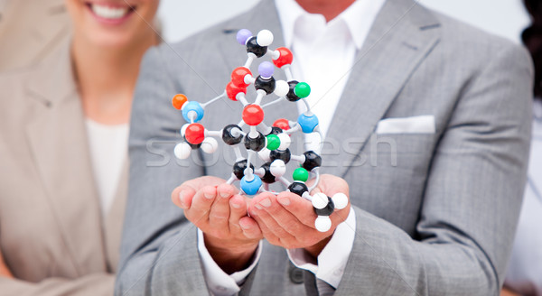Close-up of a businessman holding a molecule  Stock photo © wavebreak_media